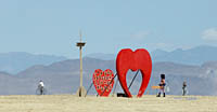 Two red hearts art display in Black Rock City