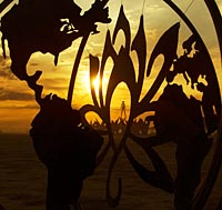 Burning man Earth and flower metal sculpture