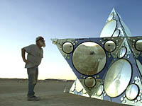 Old man looking at mirror of Constallation of One Tetrahedron