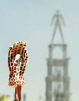 Burning man in the background of love hand art sculpture made of mosaic