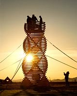 Sunrise silhouettes of double helix wooden art installation