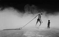 Figure pulling large key in desert