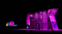 Night picture of OINK and Megatropolis Burning Man art installations