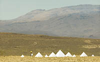 Small Burning Man pyramids in open desert