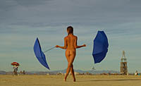 Hot girl dancing with umbrellas at Burning Man