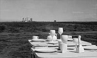 White tables white spoons, white plates, white bottles desert bistro
