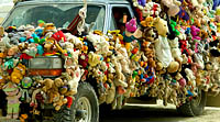 Picture of thousands of stuffed animals decorating the playa car
