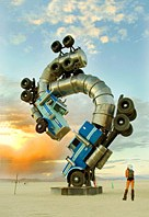 Burning Man Big Rig Jig sunset and girl looking at giant art installation surreal sculpture