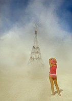 Burning Man Girls taking pictures of Elevation Tower by Michael Christian