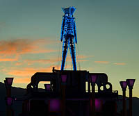 Neon silhouette of Burning Man edifice