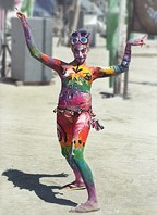 Red, green, yellow body painted woman