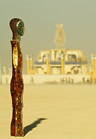 Slim mosaic sculpture in front of Burning man