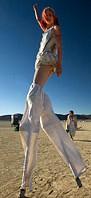 girl walking on stilts