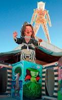 Painted clown below the man