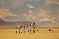 Singing drinking water bottles in desert