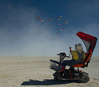 disabled man flying the kite in black rock desert