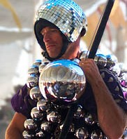 Man in Center camp dressed in ball suit