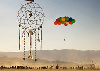 Burning Man art sculpture and Balloon performance