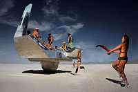 Burning Man people dancing around the interstellar ship