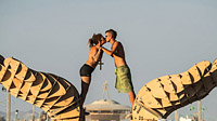 Kissing young couple in front of the the Burning Man 2013