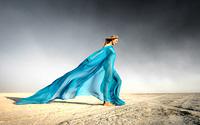 Dreaming and walking girl in desert