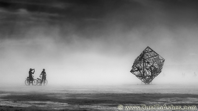 Black and White photo of cube art installation in dust storm