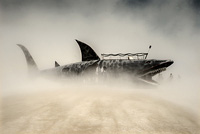 Shark diving into a sea of dust