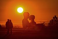 Silhouette of Embrace couple against the desert Sunrise