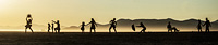 Silhouettes of playful people in the morning sun