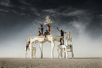 White kitchen table in desert art installation