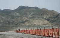 Girl running at the Burning Man perimeter