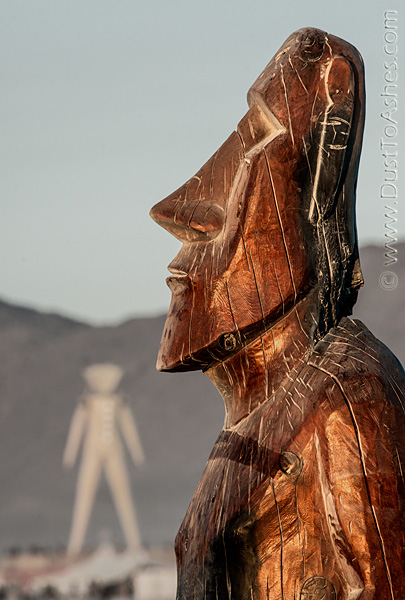 Head looking at the Burning Man statue