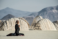 Girl meditating in desert