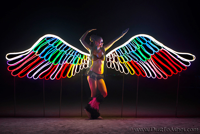 Burning Man girl in the night costume