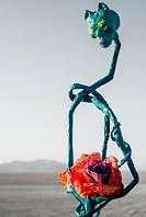 Flower in hands of alien