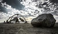 Laying rock in desert