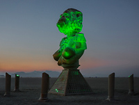 Illuminated bust of ape