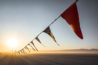 colorful flags decorating the road to Burning Man