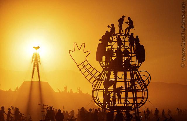 People climbing art installation